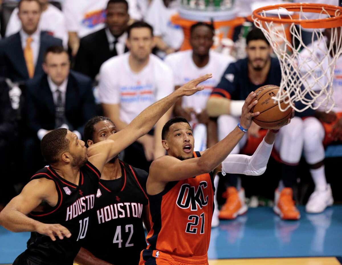 Oklahoma City Thunder forward Andre Roberson (21) goes to the basket against Houston Rockets guard Eric Gordon (10) and Houston Rockets center Nene Hilario (42) during the first quarter of Game 4 of the NBA Western Conference first-round playoff series at Chesapeake Energy Arena on Sunday, April 23, 2017, in Oklahoma City.