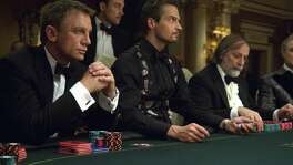 "Sony's contract to market and distribute the James Bond films has expired so the two companies that control the franchise but do not distribute their own films reportedly have started attending dog-and-pony shows put on by studios that want the rights. Shown is Daniel Craig (left) in his debut as the suave British spy James Bond in ""Casino Royale."""