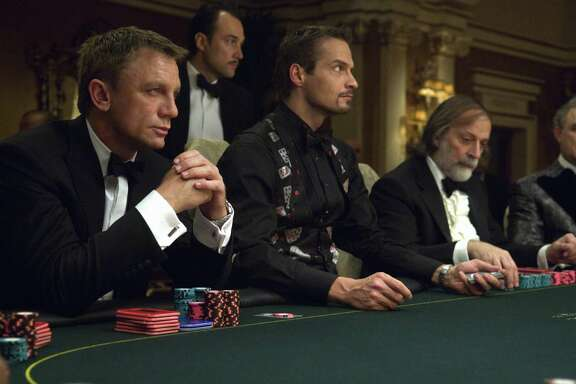 """Sony's contract to market and distribute the James Bond films has expired so the two companies that control the franchise but do not distribute their own films reportedly have started attending dog-and-pony shows put on by studios that want the rights. Shown is Daniel Craig (left) in his debut as the suave British spy James Bond in """"Casino Royale."""""""