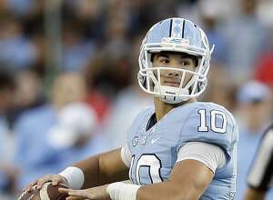 FILE - In this Nov. 19, 2016, file photo, North Carolina quarterback Mitch Trubisky (10) looks to pass against The Citadel during the first half of an NCAA college football game in Chapel Hill, N.C. Trubisky has the arm, athleticism, and quick delivery NFL teams love, but one year as a starter in spread offense means he has a lot to learn.  (AP Photo/Gerry Broome, File)