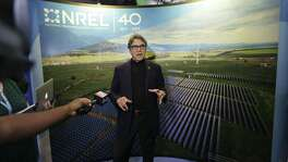 U.S. Secretary of Energy Rick Perry speaks to reporters at an Earth Day display at Fair Park in Dallas, Friday, April 21, 2017. (AP Photo/LM Otero)