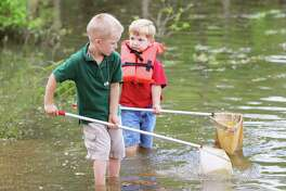 Brothers Noah and Joseph are dip netting and trying to figure out what it is they have collected in their nets.