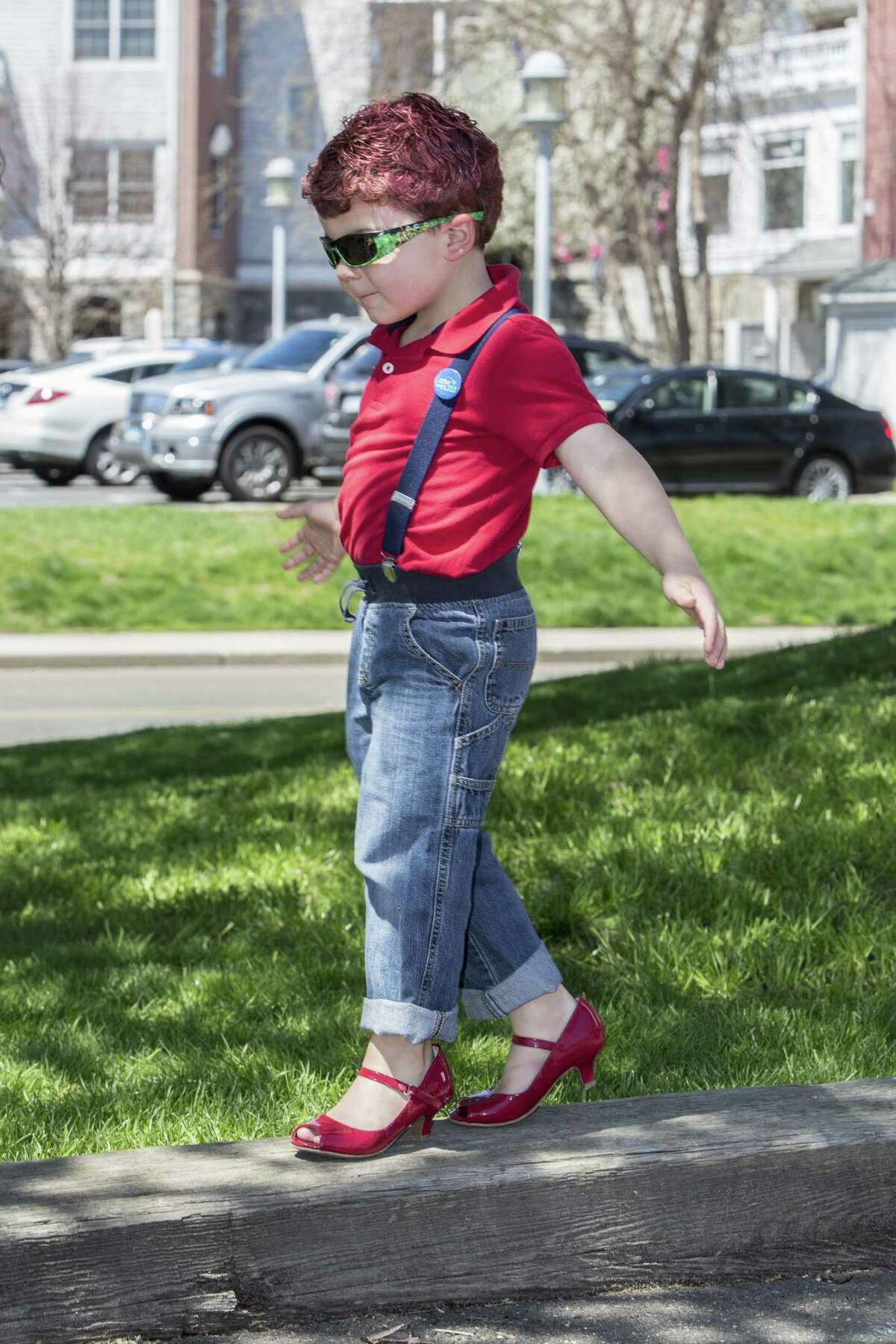 Nathan Dezenzo, 4, plays at Lisman Landing in Milford, Conn wearing ladies shoes in accordance with the playful rules of the Walk A Mile In Her Shoes event held by The Rape Crisis Center of Milford. The event was held on Sunday, April 23, 2017. The annual walk is held to raise awareness around issues of rape, sexual assault and gender violence.