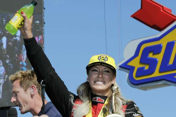 Top Fuel driver Leah Pritchett celebrates with The Wally in the winner's circle at the 30th annual NHRA Spring Nationals at the Royal Purple Raceway on Saturday, April 23, 2017 in Baytown, TX.