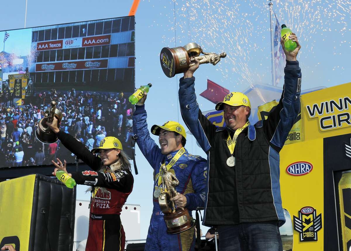 Top Fuel driver Lea Pritchett (left), Funny Car driver Ron Capps (center), and Pro Stock driver Bo Butner (right) celebrate in the winner's circle at the 30th annual NHRA Spring Nationals at the Royal Purple Raceway on Saturday, April 23, 2017 in Baytown, TX.