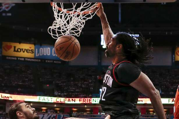 Houston Rockets center Nene (42) dunks over Oklahoma City Thunder center Steven Adams (12) during the second half Game 4 of the NBA Western Conference first-round playoff series at Chesapeake Energy Arena on Sunday, April 23, 2017, in Oklahoma City. The Rockets beat the Thunder 113-109, to take a 3-1 lead in the best-of-seven series. ( Brett Coomer / Houston Chronicle )