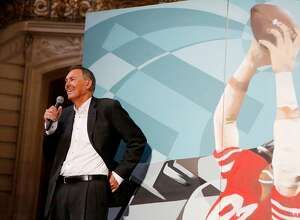 Dwight Clark speaks in front of a mural dedicated to the 49ers at a ceremony in City Hall on Sunday, April 23, 2017, in San Francisco, Calif.