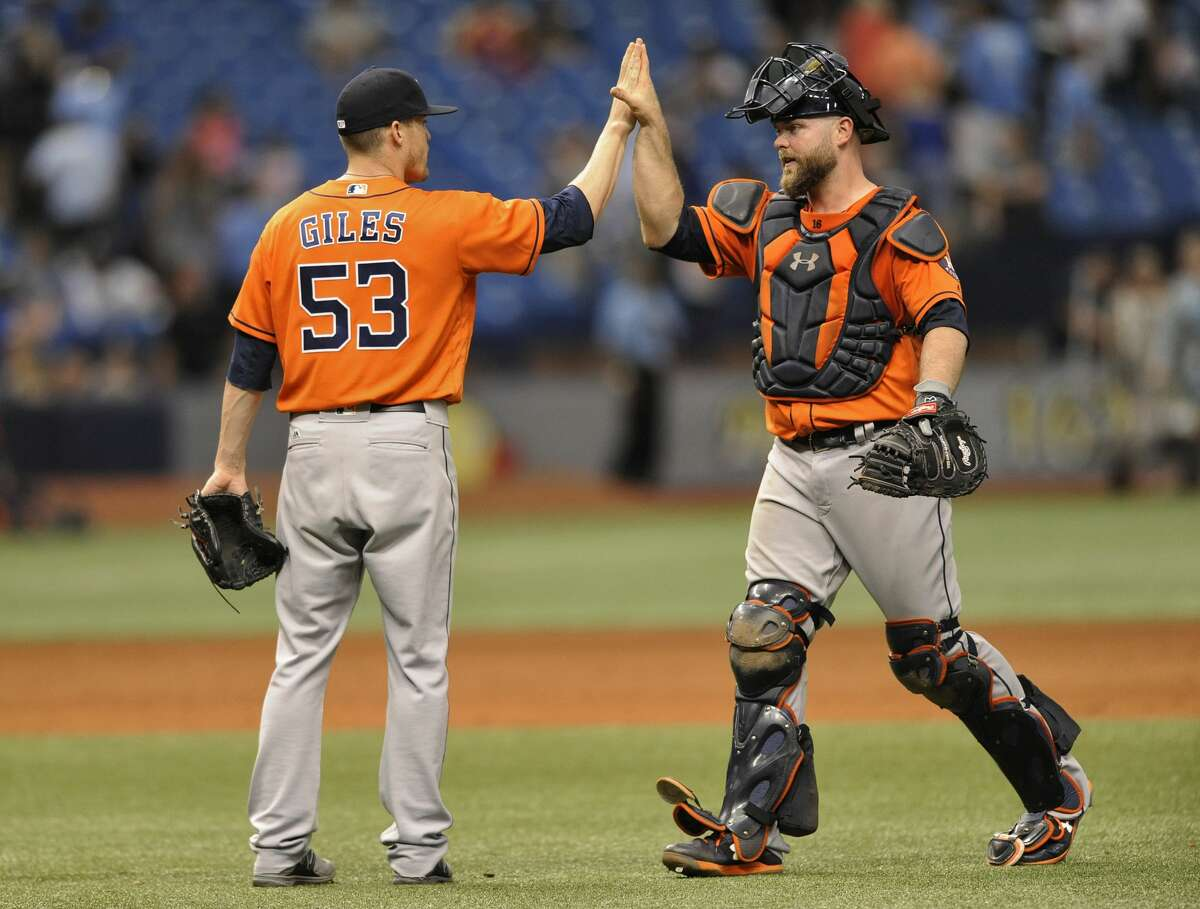Houston Astros reliever Ken Giles (53) and catcher Brian McCann celebrate a 6-4 win over the Tampa Bay Rays during the 10th inning of a baseball game, Sunday, April 23, 2017, in St. Petersburg, Fla. (AP Photo/Steve Nesius)