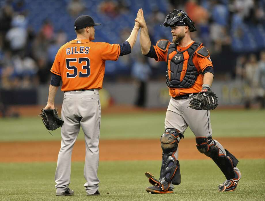 Houston Astros reliever Ken Giles (53) and catcher Brian McCann celebrate a 6-4 win over the Tampa Bay Rays during the 10th inning of a baseball game, Sunday, April 23, 2017, in St. Petersburg, Fla. (AP Photo/Steve Nesius) Photo: Steve Nesius/Associated Press