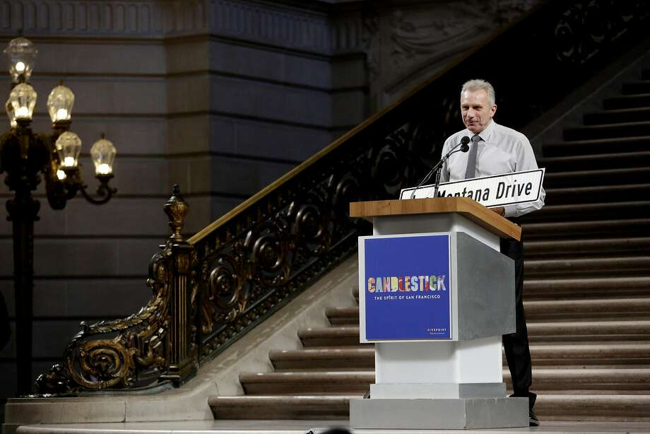 Former 49er Joe Montana accepts the honor of having a street named after him at City Hall last Sunday. Photo: Natasha Dangond, The Chronicle