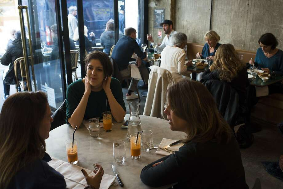 Diners eat at Le 52 Faubourg Saint-Denis, a popular neo-brasserie in a rapidly gentrifying portion of Paris' 10th arrondissement. Photo: Pete Kiehart, Special To The Chronicle