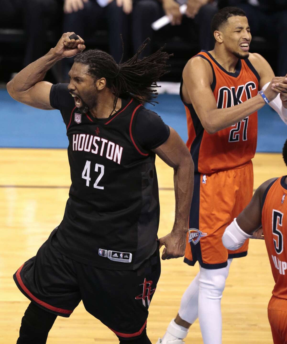 Houston Rockets center Nene (42) celebrates after scoring on Oklahoma City Thunder forward Andre Roberson (21) during the fourth quarter of Game 4 of the NBA Western Conference first-round playoff series at Chesapeake Energy Arena on Sunday, April 23, 2017, in Oklahoma City. The Rockets beat the Thunder 113-109, to take a 3-1 lead in the best-of-seven series. ( Brett Coomer / Houston Chronicle )
