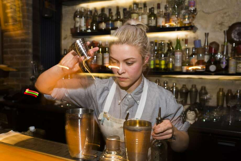 Bartender Emily Reynolds mixes cocktails at Little Red Door, a speakeasy-style bar in the Marais. Photo: Pete Kiehart, Special To The Chronicle