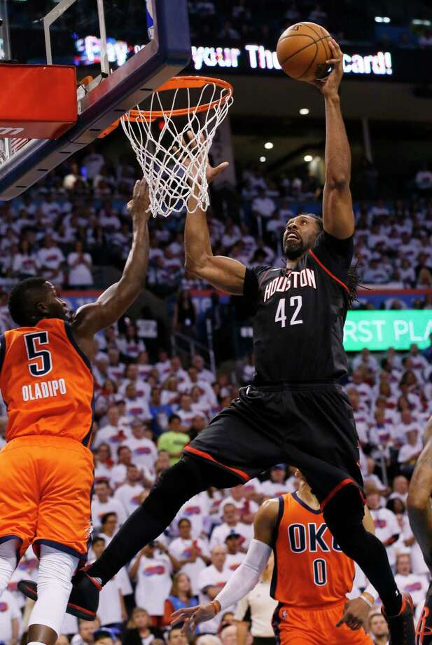 Houston Rockets center Nene (42) shoots in front of Oklahoma City Thunder guard Victor Oladipo (5) in the first quarter of Game 4 of a first-round NBA basketball playoff series in Oklahoma City, Sunday, April 23, 2017. (AP Photo/Sue Ogrocki) Photo: Sue Ogrocki, STF / AP2017