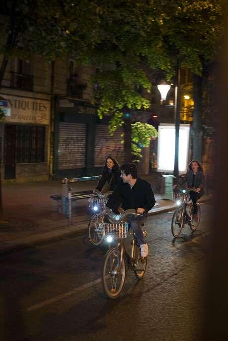 Velib users ride through the Oberkampf neighborhood. Photo: Pete Kiehart, Special To The Chronicle