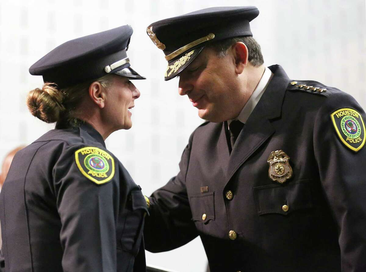 Houston Police Chief Art Acevedo pins the badge on cadet Wendy Caldwell during last month's cadet graduation ceremony.  Officer Caldwell, 53, served HPD for 18 years before she retired to raise her children. She  is the oldest cadet graduate in the HPD history.