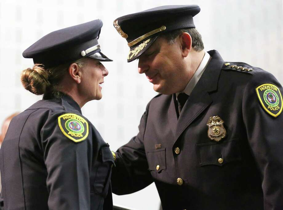 Houston Police Chief Art Acevedo pins the badge on cadet Wendy Caldwell during last month's cadet graduation ceremony.  Officer Caldwell, 53, served HPD for 18 years before she retired to raise her children. She  is the oldest cadet graduate in the HPD history.  Photo: Yi-Chin Lee, Staff / © 2017  Houston Chronicle
