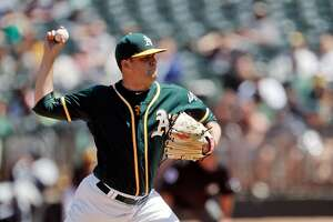 Andrew Triggs (60) started for the A's and gave up six earned runs as the Oakland Athletics played the Seattle Mariners at Oakland Coliseum in Oakland, Calif., on Sunday, April 23, 2017.