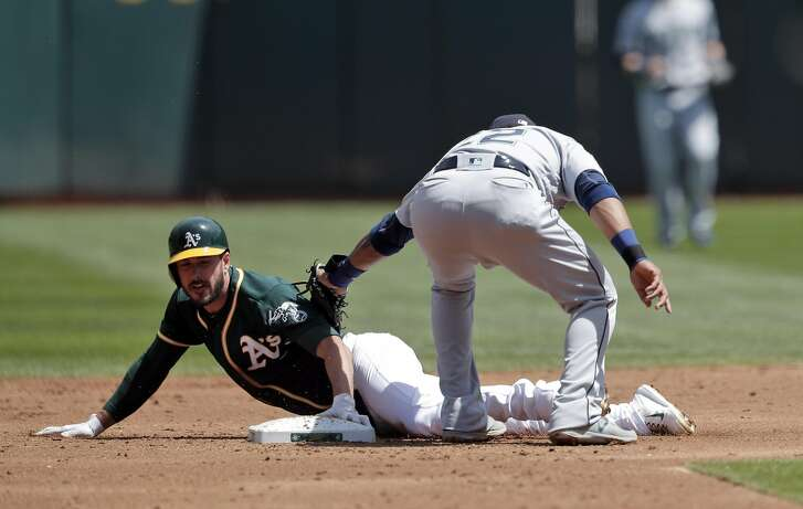 Matt Joyce (23) safe at second after taking the base on a wild pitch in the second inning as the Oakland Athletics played the Seattle Mariners at Oakland Coliseum in Oakland, Calif., on Sunday, April 23, 2017.