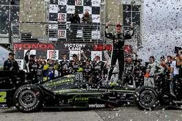 Josef Newgarden celebrates after winning the Indy Grand Prix of Alabama auto race, Sunday, April 23, 2017, in Birmingham, Ala. (AP Photo/Butch Dill)