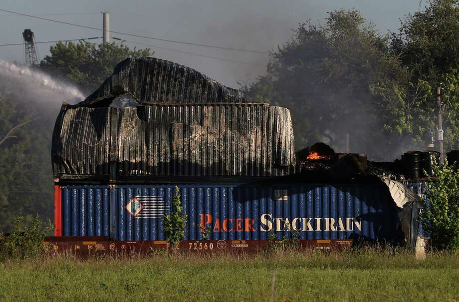 HFD firefighters working on to put off fire from a shipping container on the railroad near Conti and Chapman Streets Sunday, April 23, in Houston. Photo: Yi-Chin Lee / Houston Chronicle, Yi-Chin Lee / Houston Chronicle 2017