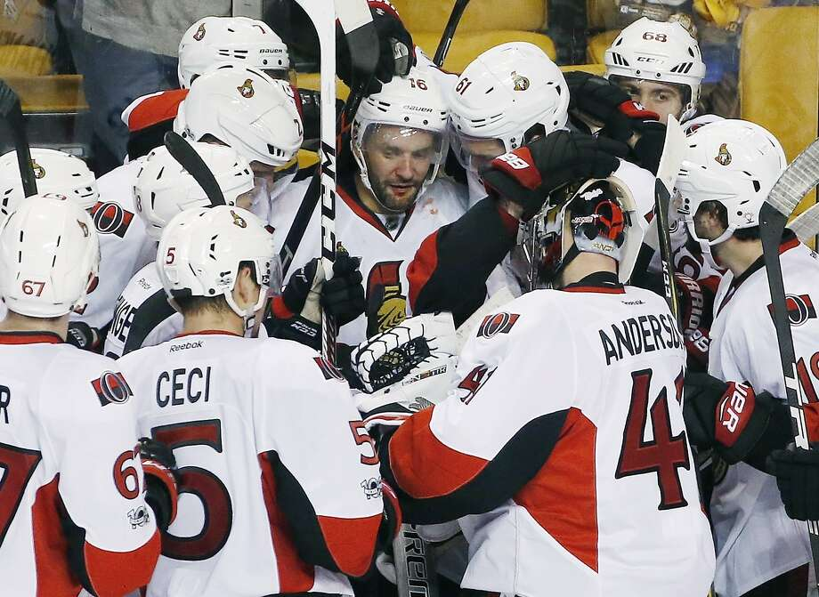 Ottawa's Clarke MacArthur is at the center of the action after scoring the series-clincher in overtime. Photo: Michael Dwyer, Associated Press