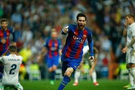 TOPSHOT - Barcelona's Argentinian forward Lionel Messi celebrates after scoring during the Spanish league Clasico football match Real Madrid CF vs FC Barcelona at the Santiago Bernabeu stadium in Madrid on April 23, 2017. / AFP PHOTO / OSCAR DEL POZOOSCAR DEL POZO/AFP/Getty Images