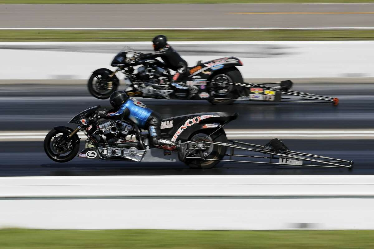 Top Fuel Harley driver Jay Turner (bottom) defeats Bob Malloy (top) in the finals at the 30th annual NHRA Spring Nationals at the Royal Purple Raceway on Sunday, April 23, 2017 in Baytown, TX.