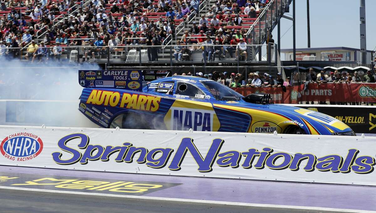 Funny Car driver Ron Capps performs a burnout at the 30th annual NHRA Spring Nationals at the Royal Purple Raceway on Sunday, April 23, 2017 in Baytown, TX.