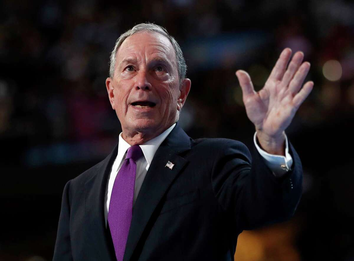 """FILE - In this Wednesday, July 27, 2016, file photo, former New York City Mayor Michael Bloomberg waves after speaking to delegates during the Democratic National Convention in Philadelphia. Bloomberg said groups are taking action against climate change because """"it's in their own best interest."""""""
