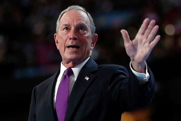 FILE - In this Wednesday, July 27, 2016, file photo, former New York City Mayor Michael Bloomberg waves after speaking to delegates during the third day session of the Democratic National Convention in Philadelphia. The former New York City mayor addressed his intensifying focus on climate change on Saturday, April 22, 2017, in an email interview with The Associated Press. Bloomberg said he wants to help save an international agreement to reduce carbon emissions. (AP Photo/Carolyn Kaster, File) ORG XMIT: NYAG701