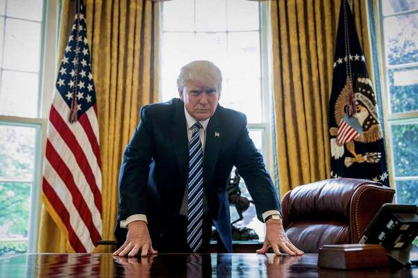 President Donald Trump poses for a portrait in the Oval Office in Washington, Friday, April 21, 2017. With his tweets and his bravado, Trump is putting his mark on the presidency in his first 100 days in office. He's flouted conventions of the institution by holding on to his business, hiring family members as advisers and refusing to release his tax returns. He's tested conventional political wisdom by eschewing travel, church, transparency, discipline, consistency and decorum. But the presidency is also having an impact on Trump, prompting him, at times, to  play the role of traditional president. (AP Photo/Andrew Harnik) ORG XMIT: WX101