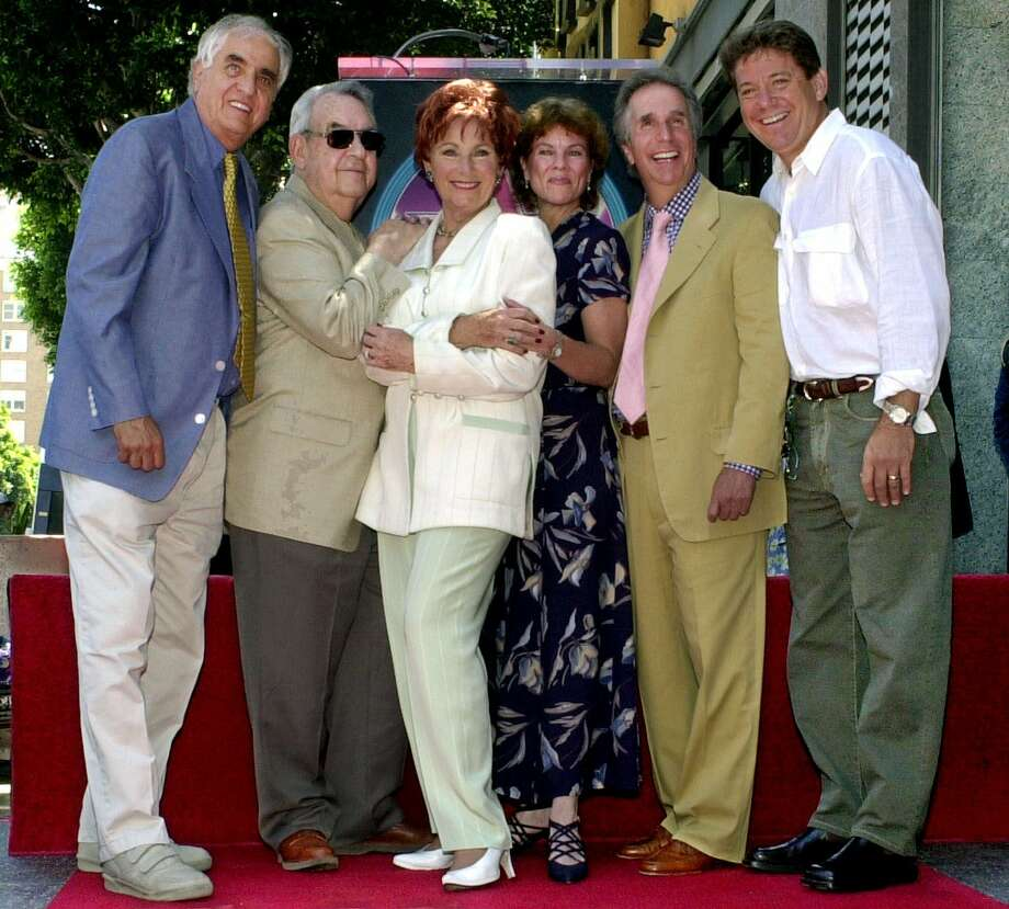 "FILE - In this July 12, 2001 file photo, Garry Marshall, from left, Tom Bosley, Marion Ross, Erin Moran, Henry Winkler, and Anson Williams of the television show ""Happy Days,"" pose after Ross received a star on the Hollywood Walk of Fame in the Hollywood section of Los Angeles. Moran, the former child star who played Joanie Cunningham in the sitcoms ""Happy Days"" and ""Joanie Loves Chachi,"" has died at age 56. Police in Harrison County, Indiana said that she had been found unresponsive Saturday, April 22, 2017, after authorities received a 911 call. (AP Photo/E.J. Flynn, File) ORG XMIT: CAET961 Photo: E.J. Flynn / AP2001"