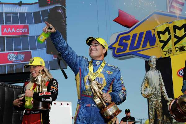 Funny Car driver Ron Capps celebrates in the winner's circle at the 30th annual NHRA SpringNationals at Royal Purple Raceway.
