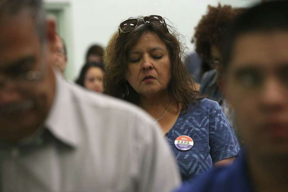 Leticia Vasquez, stands for the Closing Prayer during the Communities Organized for Public Service/Metro Alliance 2017 Accountability Session at St. Henry's Catholic Church, Sunday, April 24, 2017. San Antonio mayoral and city council candidates were invited to attend the event with questions on housing, immigration and economic security, provided in advance. About 750 members attended the event. Photo: JERRY LARA / San Antonio Express-News / © 2017 San Antonio Express-News