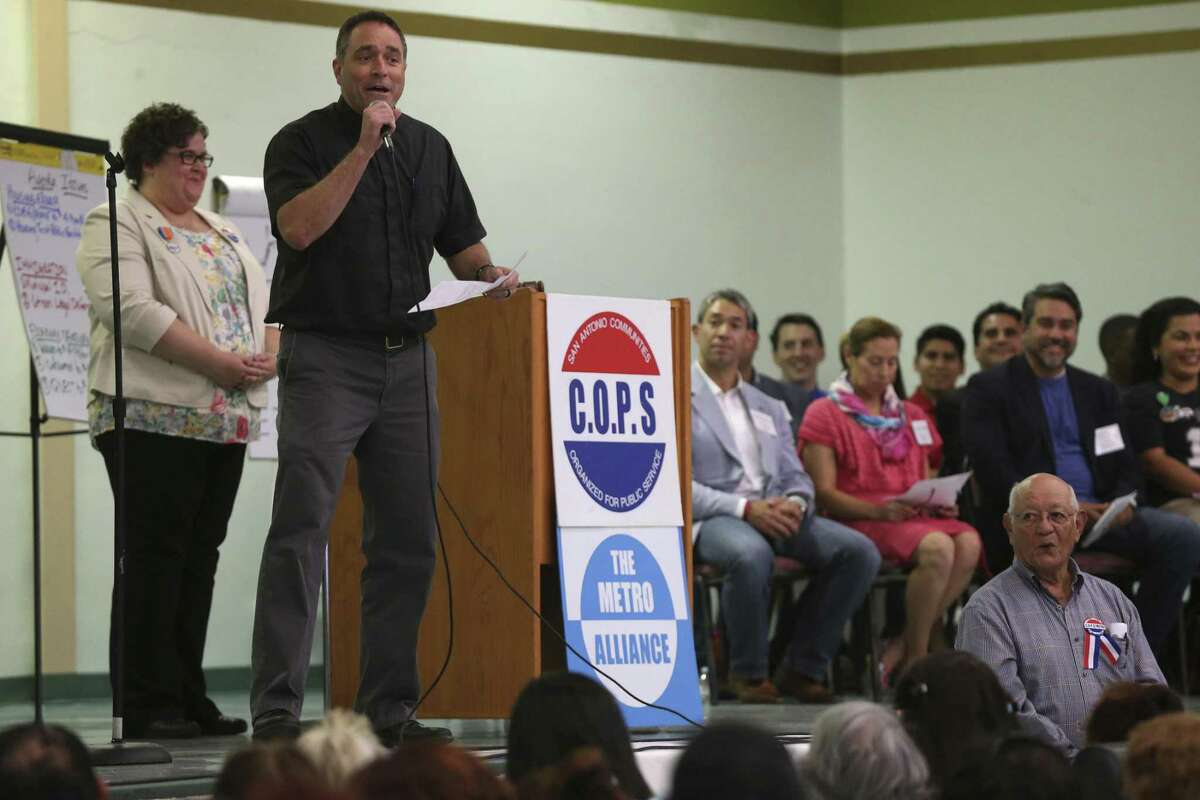The Rev. Brian Christopher of Guadalupe Catholic Church fires up the crowd during the Communities Organized for Public Service/Metro Alliance 2017 Accountability Session at St. Henry's Catholic Church April 24, 2017. San Antonio mayoral and City Council candidates were invited to the event to address questions about housing, immigration and economic security. About 750 members attended the event.