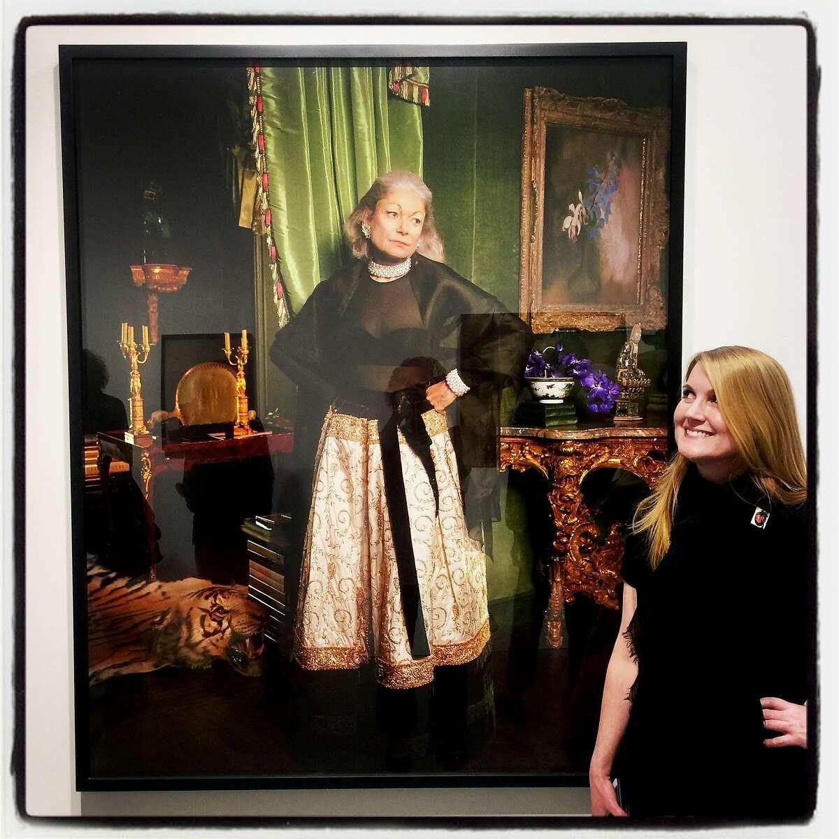 Gallerist Julie Casemore admires the Larry Sultan portrait of Denise Hale at Minnesota Street Project. April 13, 2017.