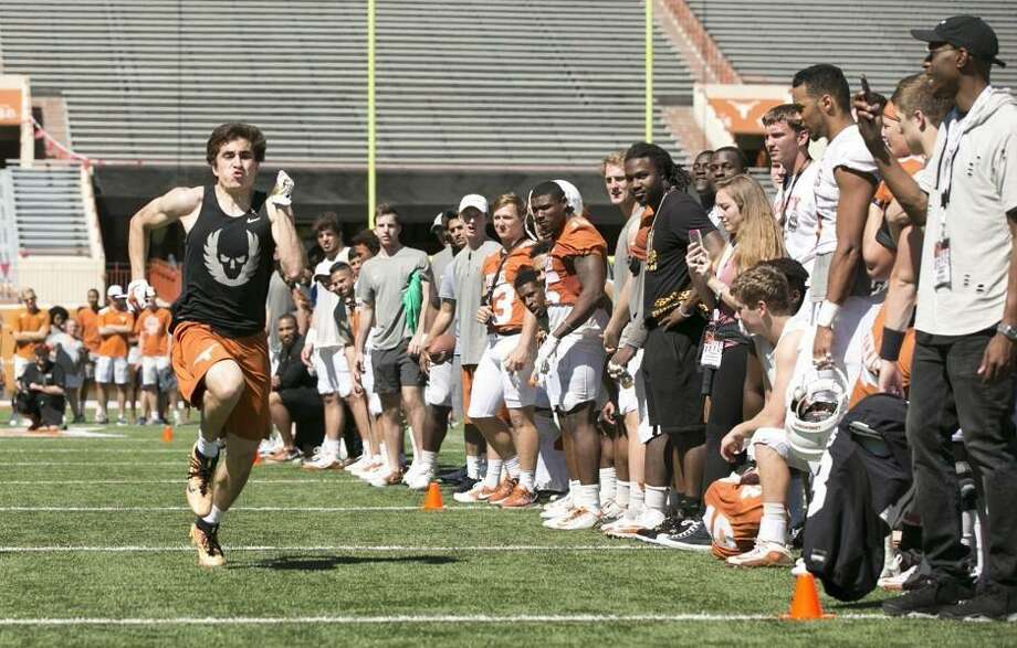 Justyn Betancourt and Mitchell Doerr beat Texas greats Aaron Ross and Michael Griffin in an obstacle course at the spring game. Photo: Courtesy Photo /