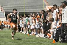 Justyn Betancourt and Mitchell Doerr beat Texas greats Aaron Ross and Michael Griffin in an obstacle course at the spring game.