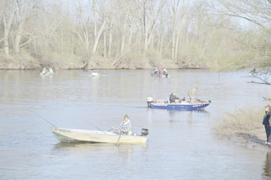 File photo for the Daily News by Steve Griffin This was the busy Tittabawassee River scene on last year's walleye season opener, at the Caldwell Ramp downstream of Midland.