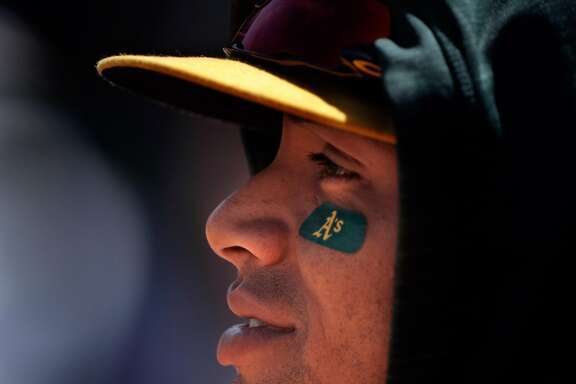 A's left fielder Khris Davis, center, during the Oakland Athletics played the Seattle Mariners at Oakland Coliseum in Oakland, Calif., on Sunday, April 23, 2017.