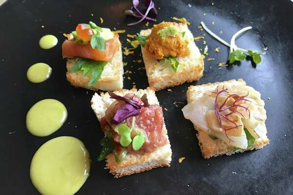 Takumi offers their take on toast, including sea urchin with lemon zest, seared scallop, fatty tuna with microgreens, and smoked salmon with avocado and caviar.
