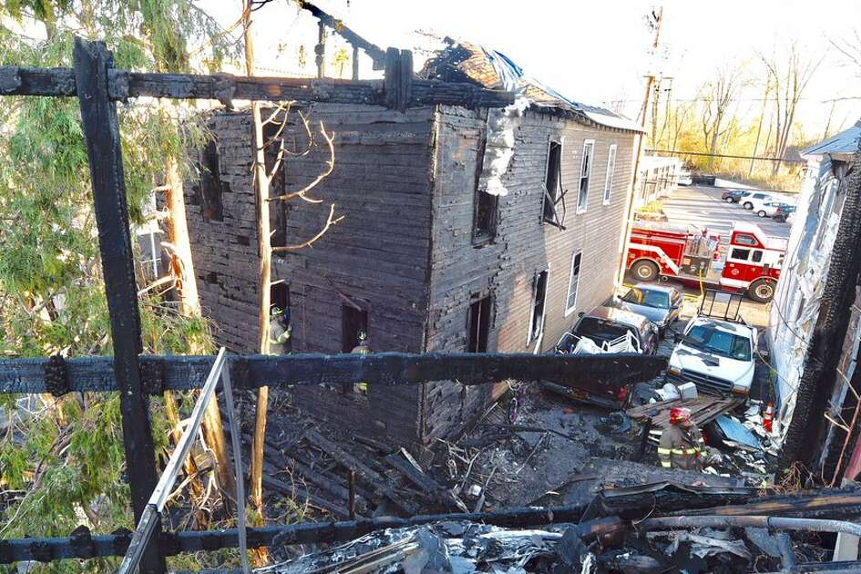 The damage is widespread at a Green Street home where a person died in fire early Monday morning.