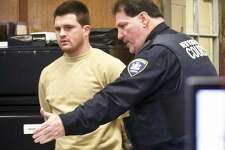 FILE — A court officer shows James Rackover to his seat as he arrives for his arraignment in criminal court, Tuesday Dec. 13, 2016, in New York. Rackover was originally charged with concealment of a human body, hindering prosecution and tampering with evidence in the stabbing death of 26-year-old Joseph Comunale from Connecticut. (AP Photo/Bebeto Matthews)