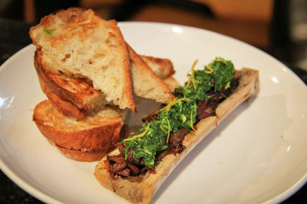 AIDS Foundation Houston presents 2017 Dining Out for Life on April 27. Participating restaurants serving breakfast, lunch or dinner will donate a portion of proceeds to support services for Houstonians living with HIV/AIDS. Shown: Bone marrow with oxtail marmalade at Lucille's, one of the participating restaurants.