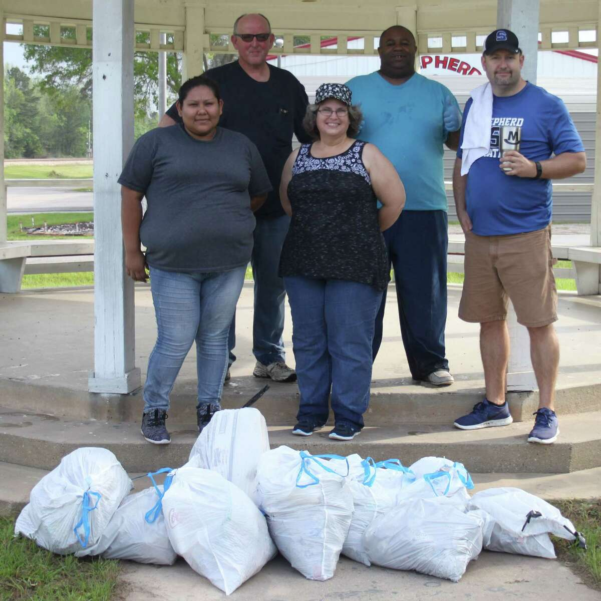 Citizens of Shepherd came together onApril 22 to clean up the city for Earth Day. Left to right are Nohemi Gonzalez, Richard Hagler, Debra Hagler, Mayor Earl Brown and Charles Minton.