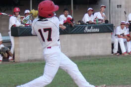 Indian Benny Gonzalez (17) connects hard with the ball in a game against Diboll.