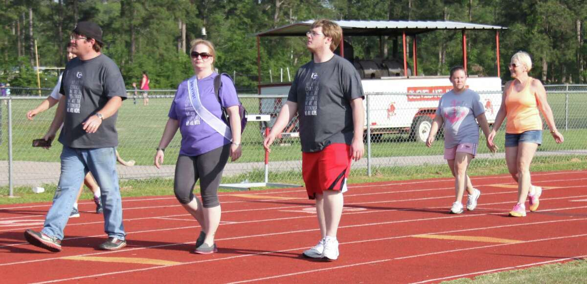 Participants in the Caregiver lap make their way around the bend of the track during Relay for Life.