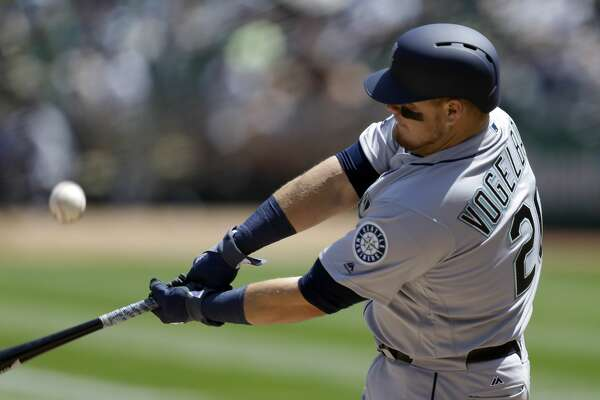 Seattle Mariners' Daniel Vogelbach bats against the Oakland Athletics in the first inning of a baseball game Sunday, April 23, 2017, in Oakland, Calif. (AP Photo/Ben Margot)