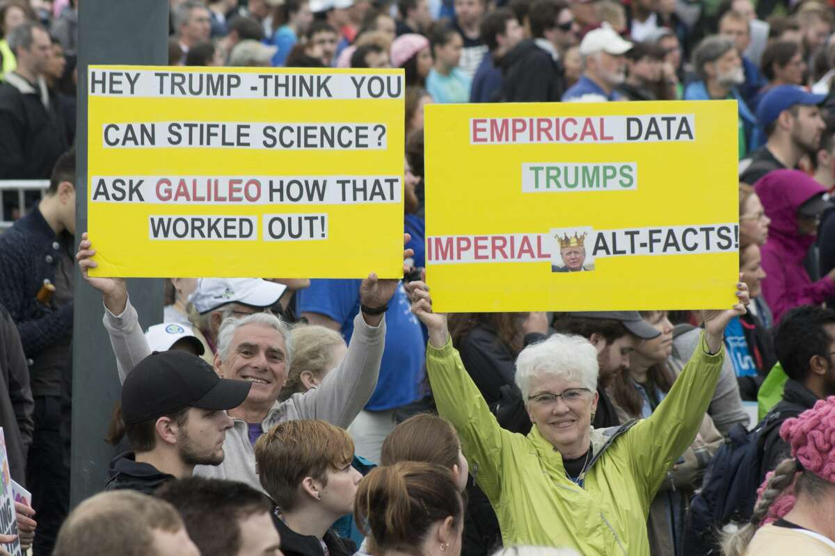 Signs held by demonstrators at the March for Science in Washington, DC on April 22, 2017.